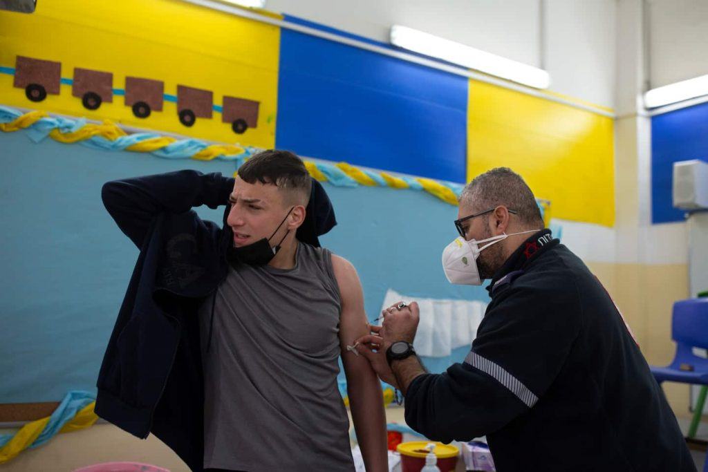 Israel agrees to vaccinate Palestinians workers, Palestinian officials say